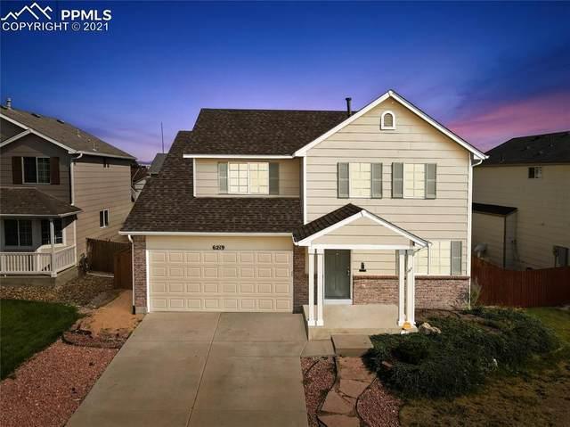 6219 Grand Mesa Drive, Colorado Springs, CO 80923 (#3917667) :: Symbio Denver