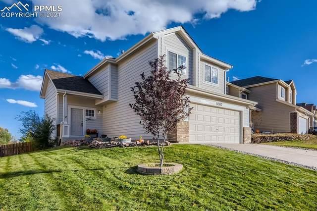 5087 Prairie Grass Lane, Colorado Springs, CO 80922 (#3935732) :: Symbio Denver