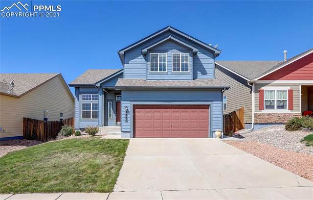 7884 Smokewood Drive, Colorado Springs, CO 80908 (#4003571) :: Tommy Daly Home Team