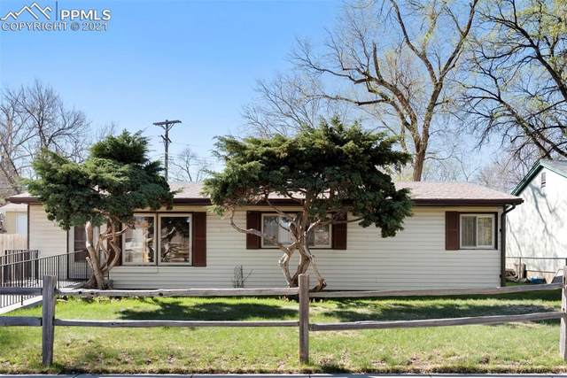 1613 Happiness Drive, Colorado Springs, CO 80909 (#4026362) :: The Daniels Team