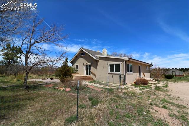 8585 Black Forest Road, Colorado Springs, CO 80908 (#4034692) :: Tommy Daly Home Team