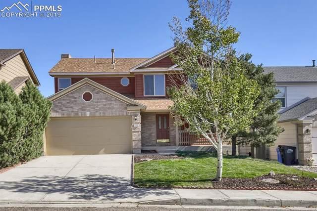 7825 Scarborough Drive, Colorado Springs, CO 80920 (#4063116) :: The Treasure Davis Team