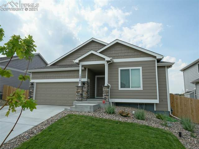 12742 Windingwalk Drive, Peyton, CO 80831 (#4152872) :: Tommy Daly Home Team