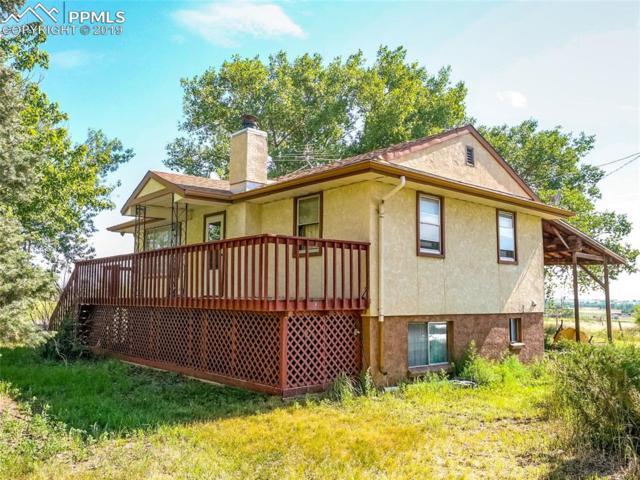 5805 N Meridian Road, Peyton, CO 80831 (#4203540) :: 8z Real Estate