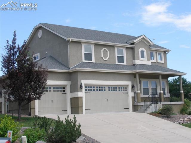 4770 Farmingdale Drive, Colorado Springs, CO 80918 (#4230927) :: CC Signature Group