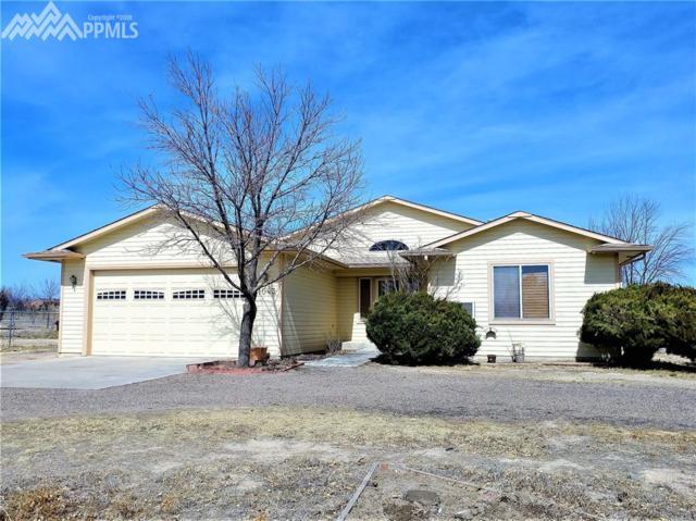 1043 W Desert Sage Drive, Pueblo West, CO 81007 (#4233834) :: The Treasure Davis Team