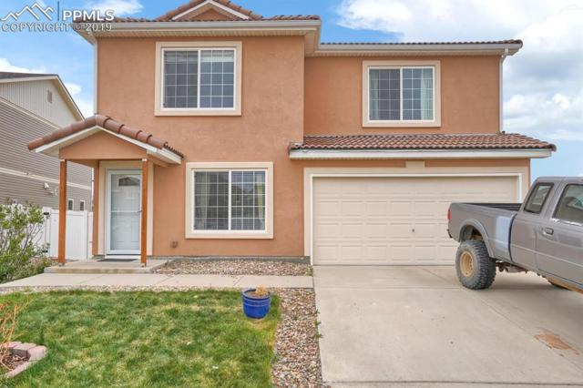 9594 Castle Oaks Drive, Fountain, CO 80817 (#4285413) :: Fisk Team, RE/MAX Properties, Inc.