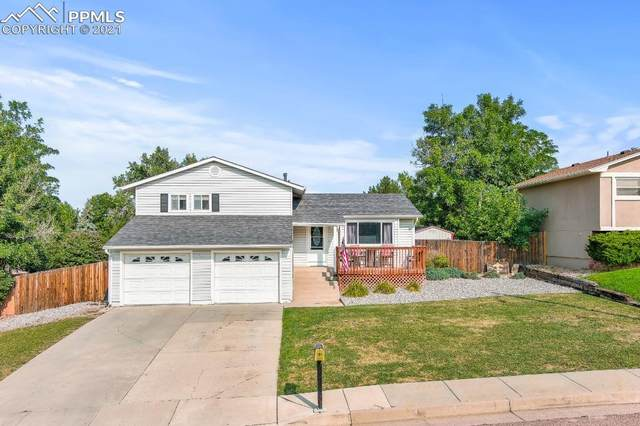 7520 Woodstock Street, Colorado Springs, CO 80911 (#4287540) :: Symbio Denver