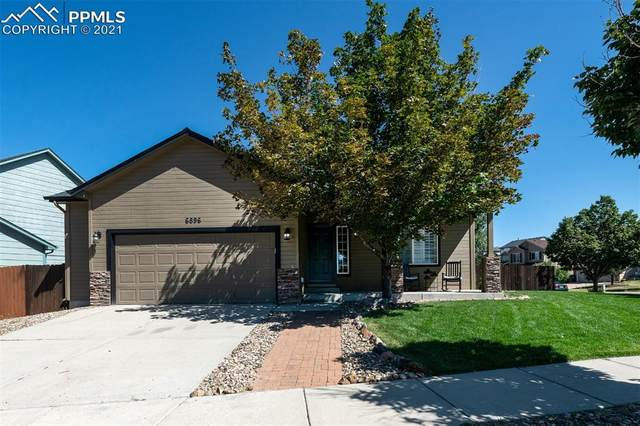 6896 Prairie Wind Drive, Colorado Springs, CO 80923 (#4332971) :: Tommy Daly Home Team