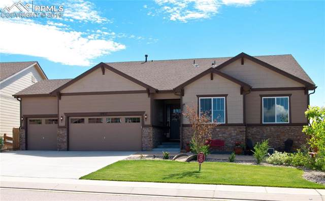 10827 Mount Evans Drive, Peyton, CO 80831 (#4345129) :: The Treasure Davis Team