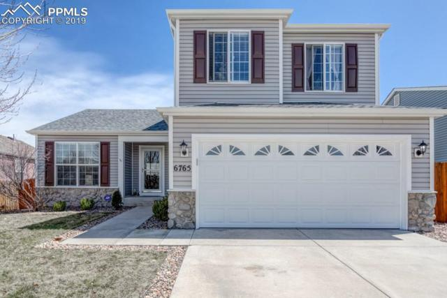 6765 Akron Road, Colorado Springs, CO 80923 (#4372197) :: Tommy Daly Home Team