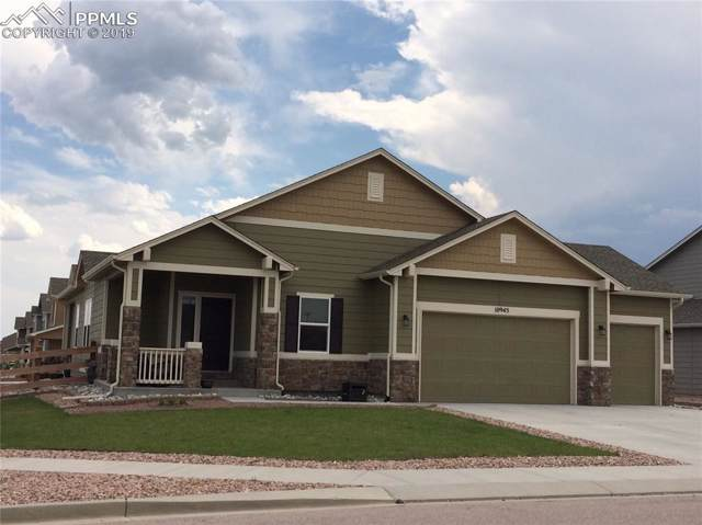 10945 Bradbury Way, Peyton, CO 80831 (#4377879) :: The Hunstiger Team