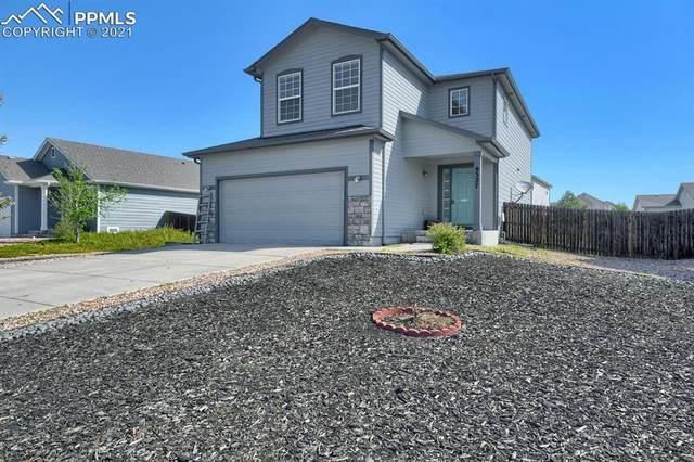 9327 Bethpage Drive, Peyton, CO 80831 (#4396176) :: The Kibler Group