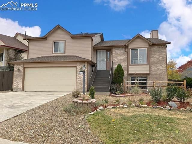 5740 E Wells Fargo Drive, Colorado Springs, CO 80918 (#4409682) :: The Scott Futa Home Team