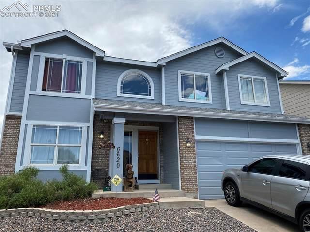 6620 Dream Weaver Drive, Colorado Springs, CO 80923 (#4414252) :: HomeSmart