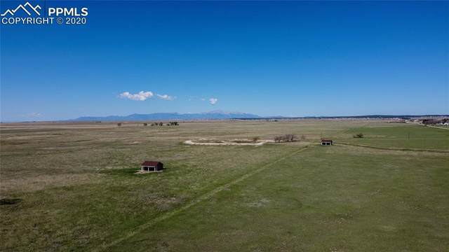 14350 Bradshaw Road, Peyton, CO 80831 (#4429770) :: The Kibler Group