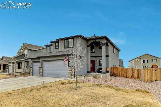 7643 Peachleaf Drive, Colorado Springs, CO 80925 (#4603784) :: The Scott Futa Home Team