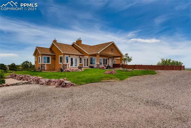 11835 Sir Galahad Drive, Colorado Springs, CO 80908 (#4724189) :: Tommy Daly Home Team