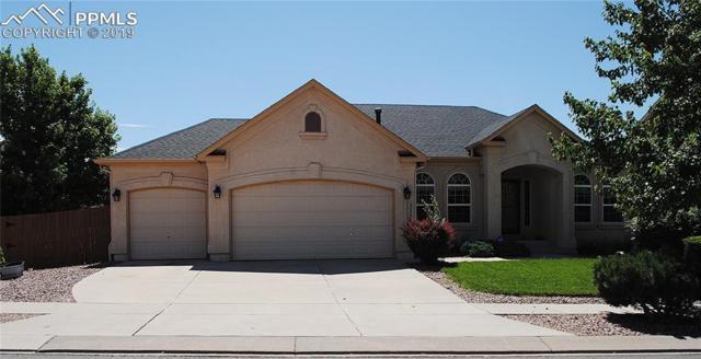 3303 Castellon Drive, Colorado Springs, CO 80916 (#4826427) :: The Kibler Group