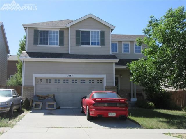 2367 Woodpark Drive, Colorado Springs, CO 80915 (#4846637) :: The Peak Properties Group