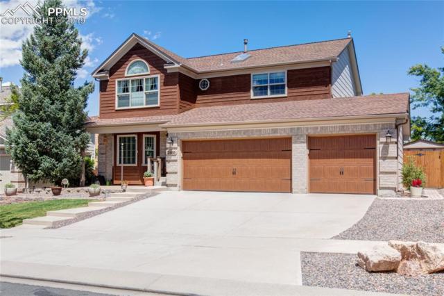 2860 Helmsdale Drive, Colorado Springs, CO 80920 (#4858254) :: The Daniels Team