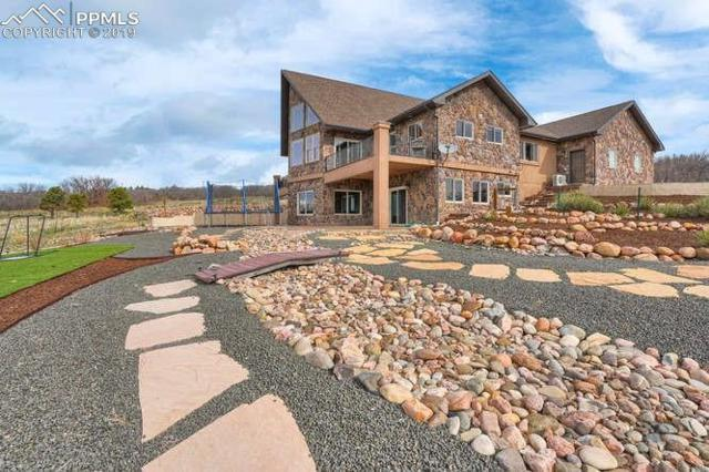 13825 Overlook Place, Colorado Springs, CO 80921 (#4883443) :: The Hunstiger Team