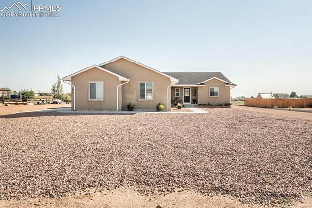 611 E Paradise Drive, Pueblo West, CO 81007 (#4894238) :: The Gold Medal Team with RE/MAX Properties, Inc