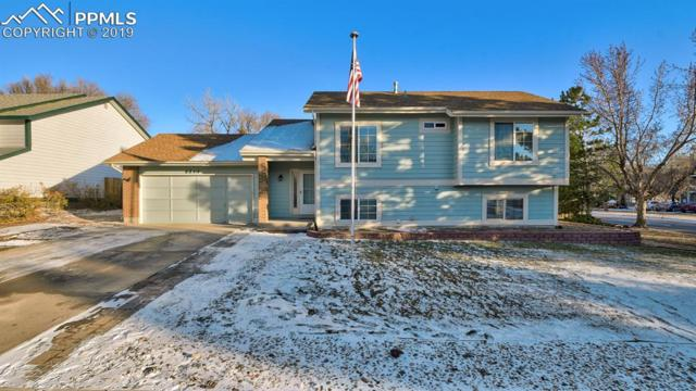 6815 Woodgate Court, Colorado Springs, CO 80918 (#5033136) :: The Kibler Group