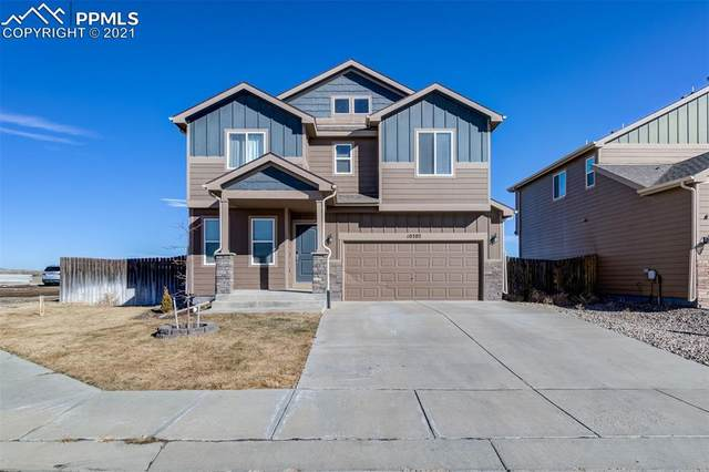 10202 Silver Stirrup Drive, Colorado Springs, CO 80925 (#5051561) :: The Scott Futa Home Team