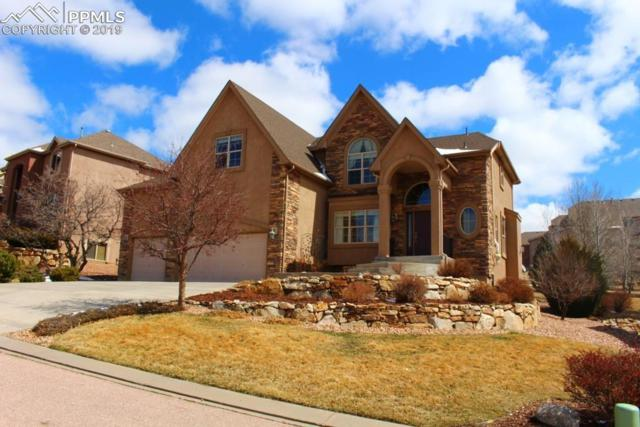 12615 Woodmont Drive, Colorado Springs, CO 80921 (#5086674) :: The Treasure Davis Team