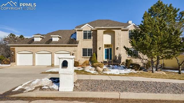 5675 Broadmoor Bluffs Drive, Colorado Springs, CO 80906 (#5108347) :: Action Team Realty
