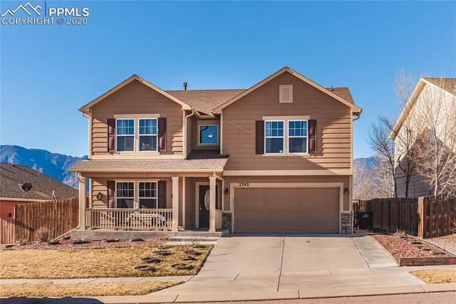 2342 Spring Blossom Drive, Colorado Springs, CO 80910 (#5198362) :: HomeSmart