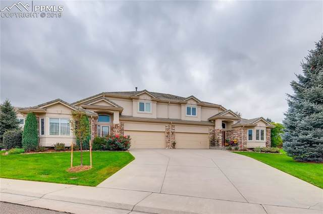 13952 E Whitaker Drive, Aurora, CO 80015 (#5270340) :: Tommy Daly Home Team