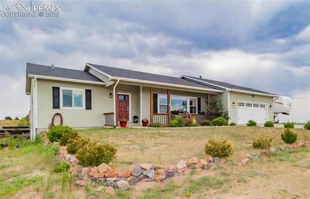 10715 Indian Paint Trail, Peyton, CO 80831 (#5290236) :: Fisk Team, RE/MAX Properties, Inc.