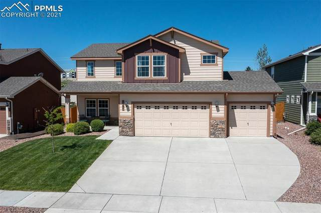 7587 Forest Valley Loop, Colorado Springs, CO 80908 (#5335382) :: Tommy Daly Home Team