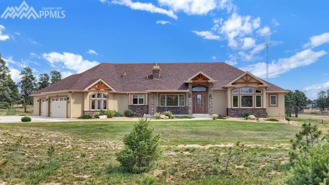 13725 Wildoak Drive, Colorado Springs, CO 80908 (#5357369) :: The Hunstiger Team