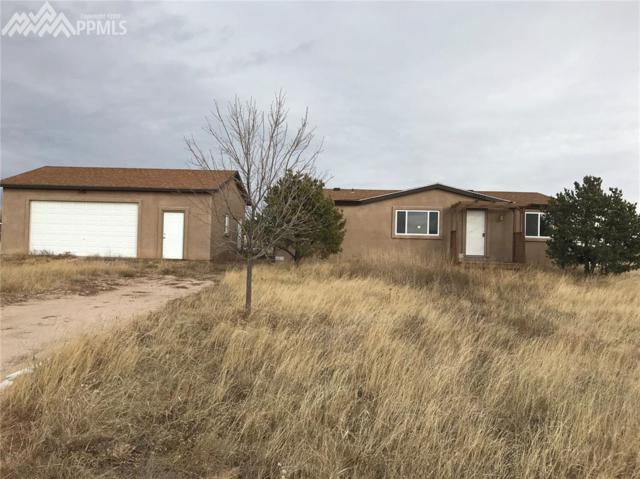 15035 Wagon Trail, Peyton, CO 80831 (#5420880) :: 8z Real Estate