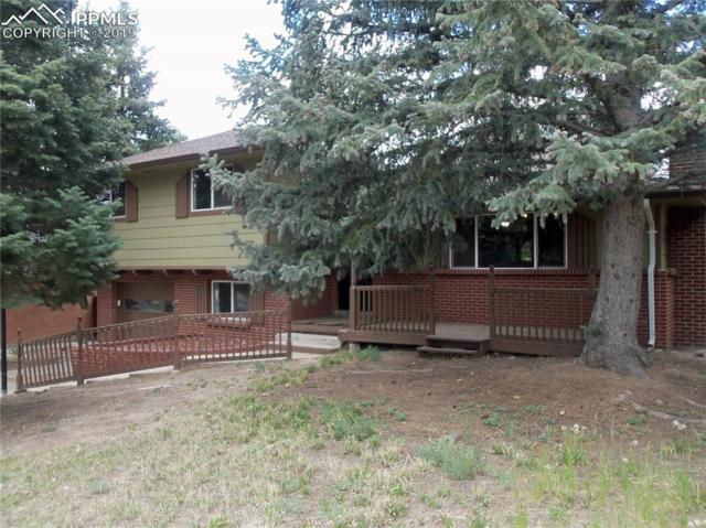 2134 Afton Way, Colorado Springs, CO 80909 (#5422916) :: The Hunstiger Team