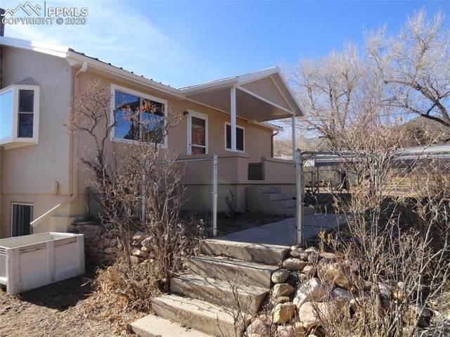 415 Rock Creek Mesa Road, Colorado Springs, CO 80926 (#5516551) :: Action Team Realty