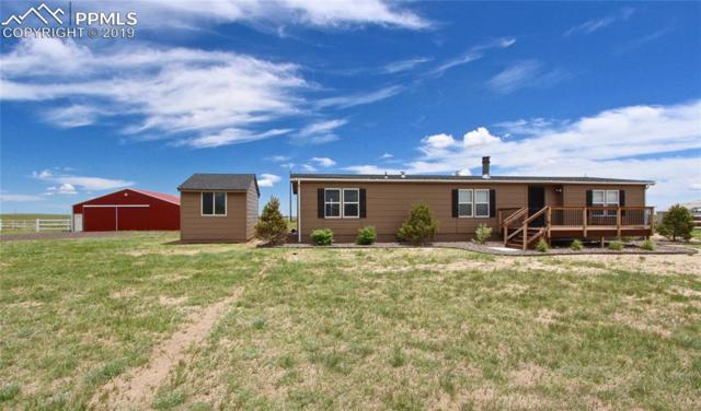 5779 Oil Baron Drive, Peyton, CO 80831 (#5569461) :: Tommy Daly Home Team
