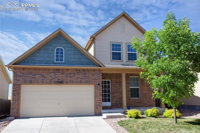 7504 Jaoul Point, Peyton, CO 80831 (#5779275) :: The Hunstiger Team