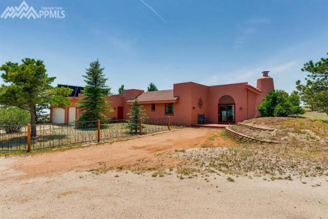 12071 Smoke Bluffs Road, Peyton, CO 80831 (#5919386) :: The Treasure Davis Team