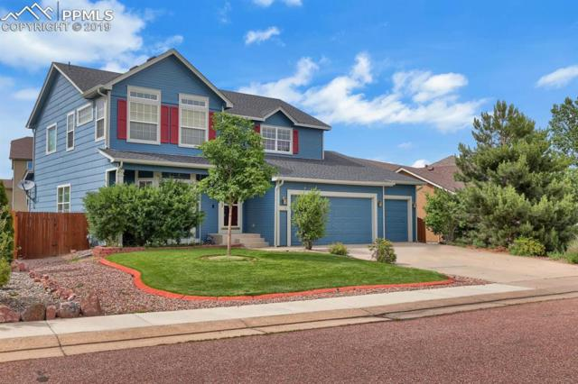 12230 Sleeping Bear Road, Peyton, CO 80831 (#6108079) :: The Kibler Group