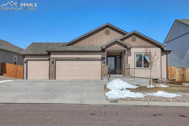6930 Forest Garden Trail, Colorado Springs, CO 80908 (#6135451) :: Action Team Realty