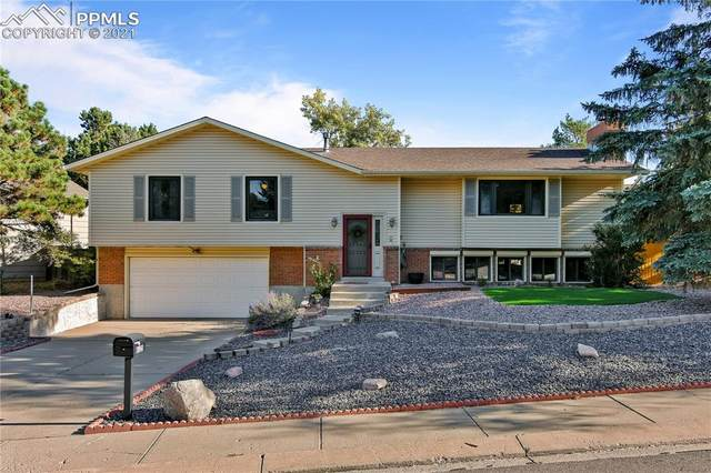 6125 Castlewood Lane, Colorado Springs, CO 80918 (#6140107) :: 8z Real Estate