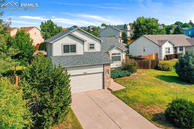 6730 Quarter Circle Road, Colorado Springs, CO 80922 (#6178139) :: The Kibler Group