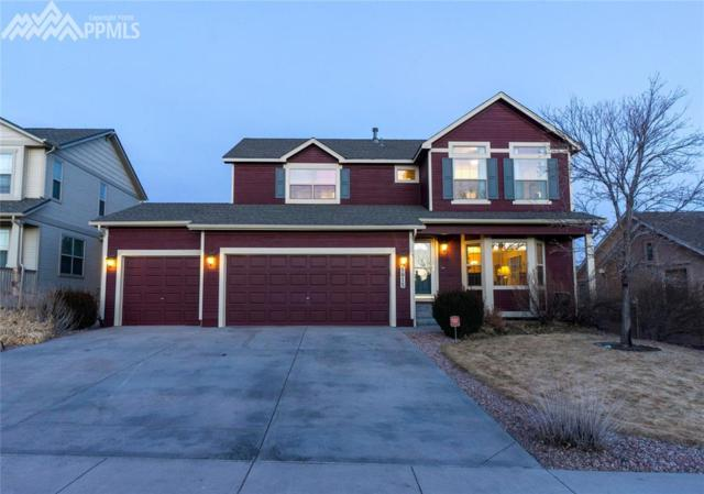 8815 Wolf Lake Drive, Colorado Springs, CO 80924 (#6189747) :: The Hunstiger Team