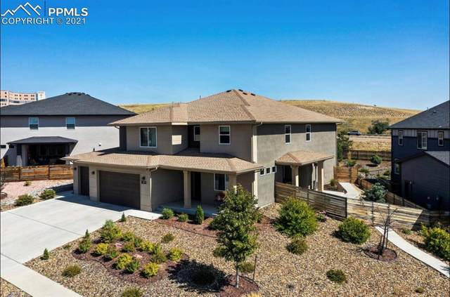 7079 Sungold Drive, Colorado Springs, CO 80923 (#6211375) :: The Gold Medal Team with RE/MAX Properties, Inc