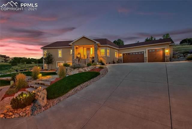 12427 Oak Hollow Court, Colorado Springs, CO 80921 (#6294892) :: The Artisan Group at Keller Williams Premier Realty