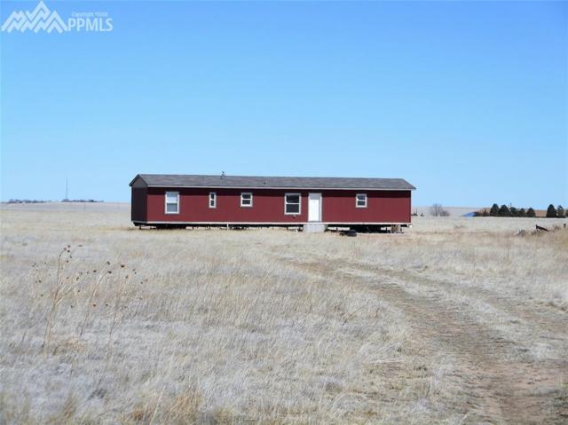 6855 S Lauppe Road, Yoder, CO 80864 (#6313388) :: The Peak Properties Group